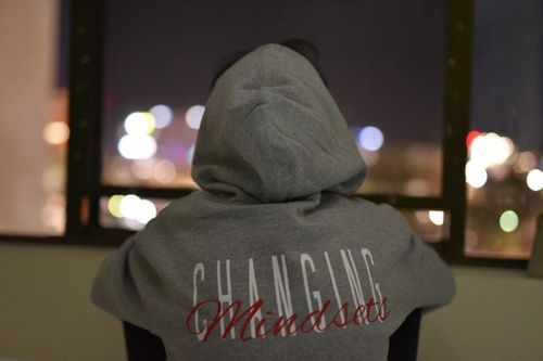 Girl wearing changing mindsets hoodie