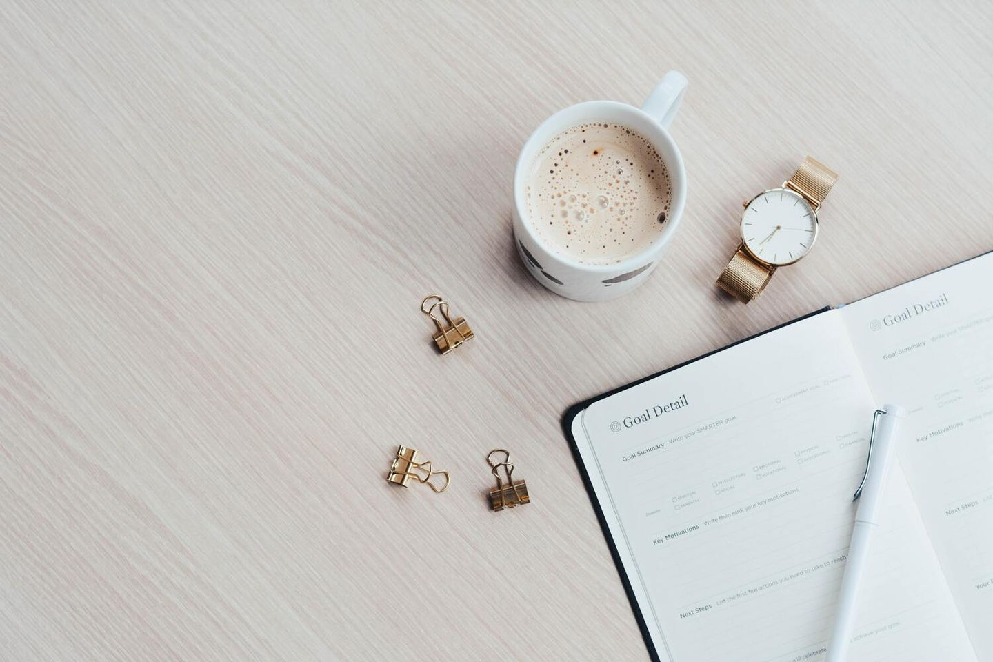 image of freelancer in morning routine with coffee and journal