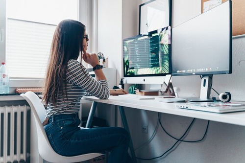 image of freelancer writing her first invoice on computer