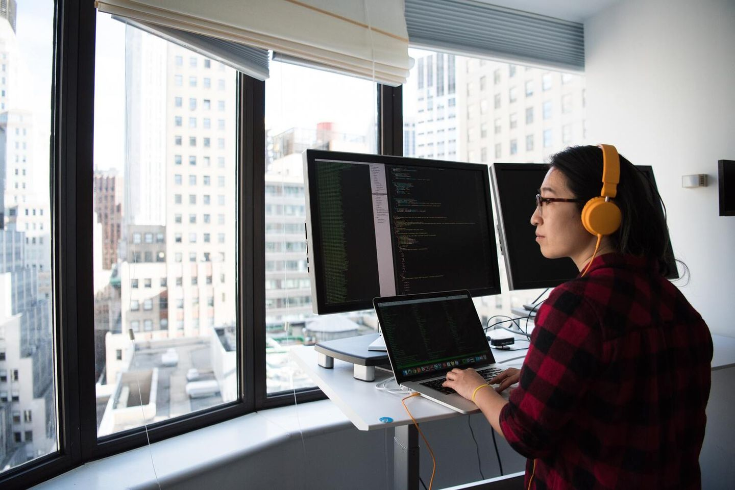 Woman brainstorming in front of computer wondering what is the main purpose of brainstorming