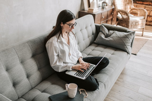 Woman writing a follow up email with client