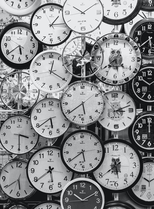 Wide array of black and white clocks indicating time and urgent tasks
