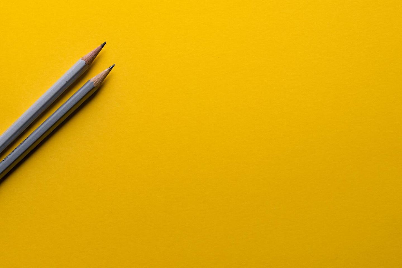 2 pencils representing a creative title