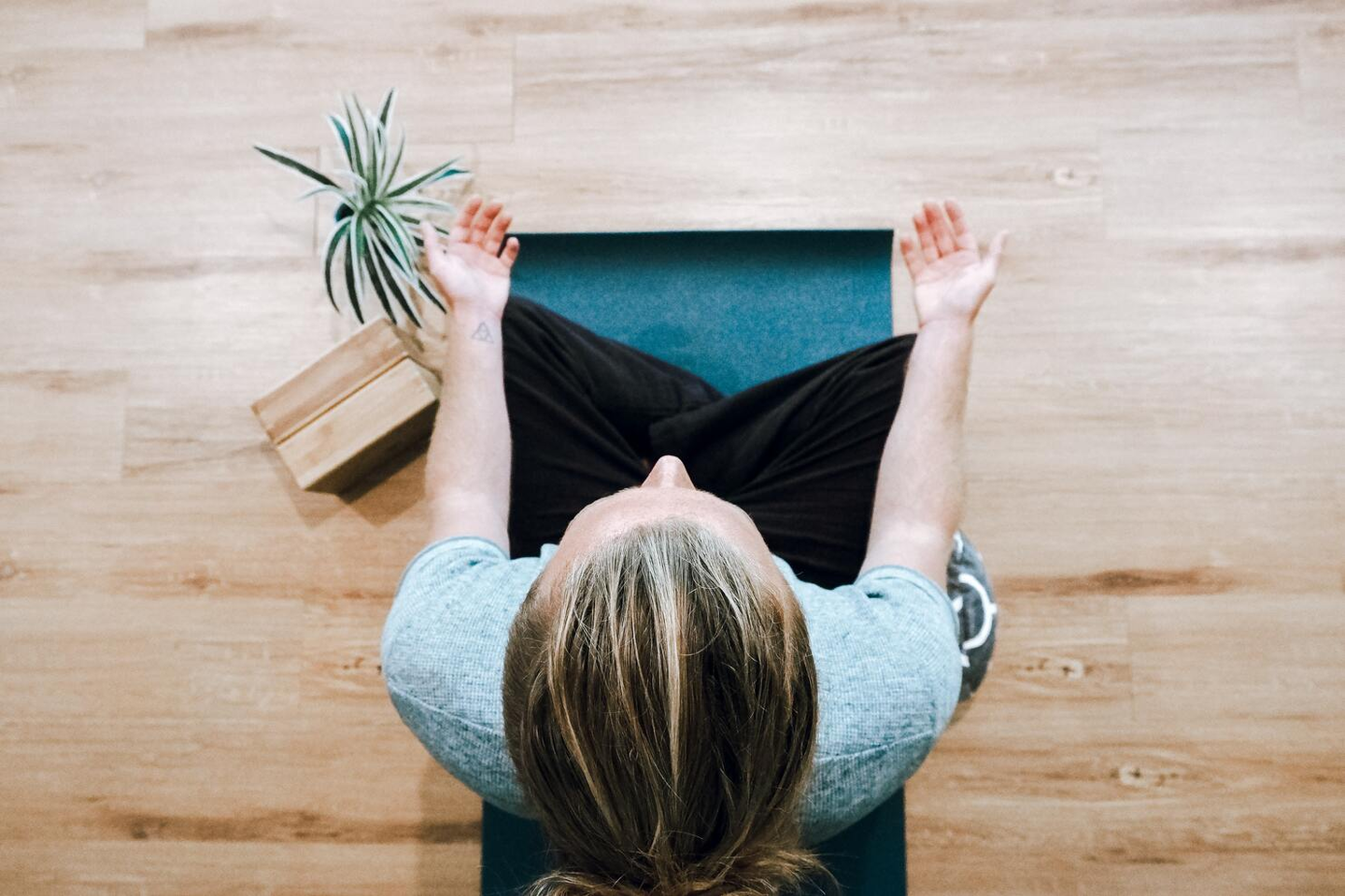 Image of freelancer practicing mindfulness to boost productivity