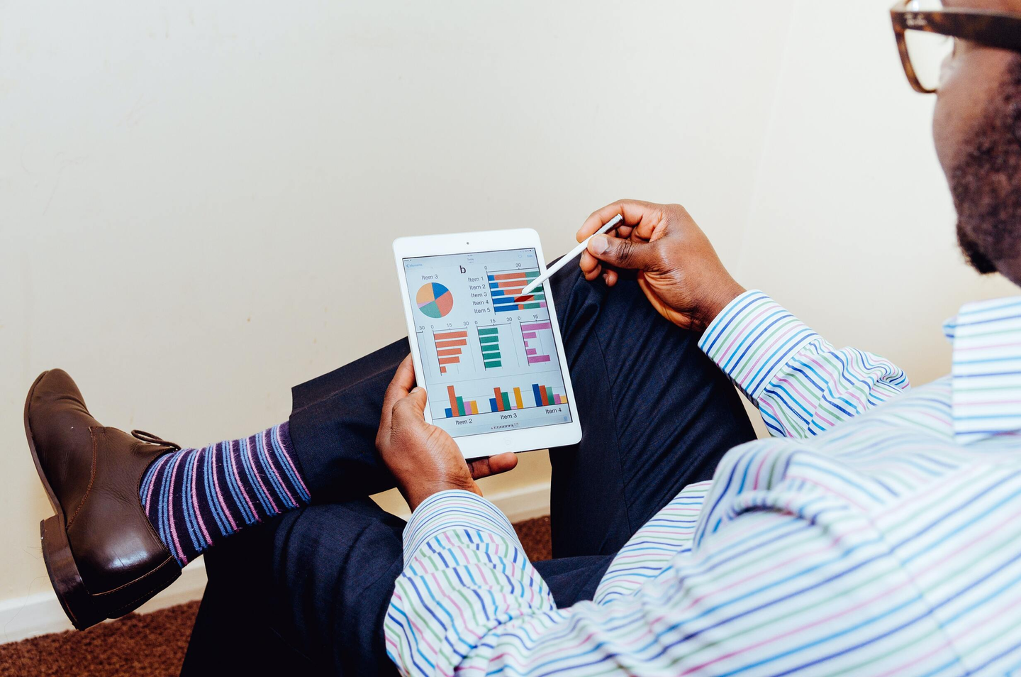 Man looking at financial analytics on a tablet