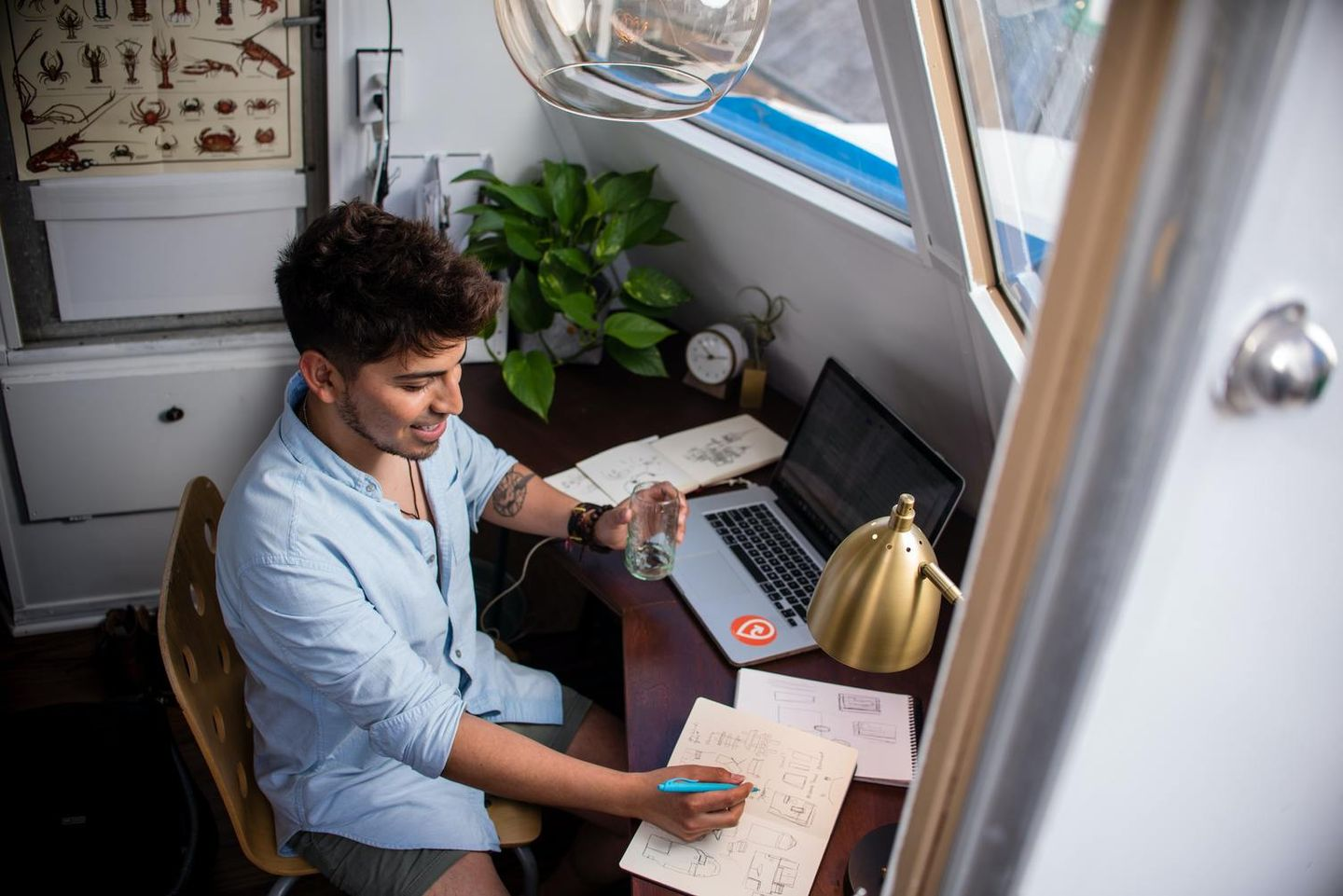 Freelancer looking for work at desk with laptop