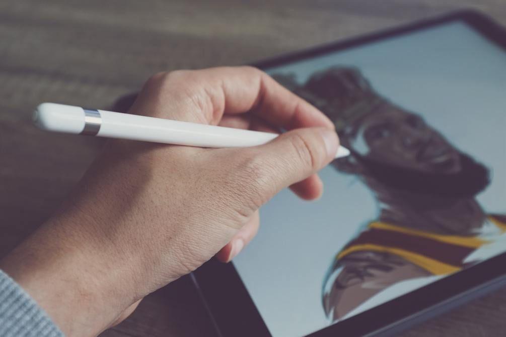 Freelance illustrator designing visual art on a digital pad.