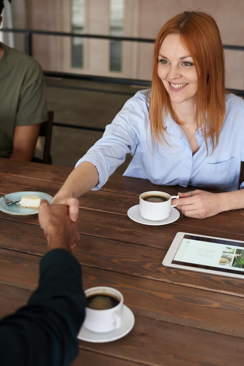 Woman freelancer meeting a potential client through networking and shaking hands