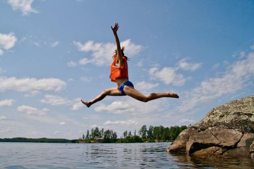 Person leaping in the air celebrating becoming a freelancer