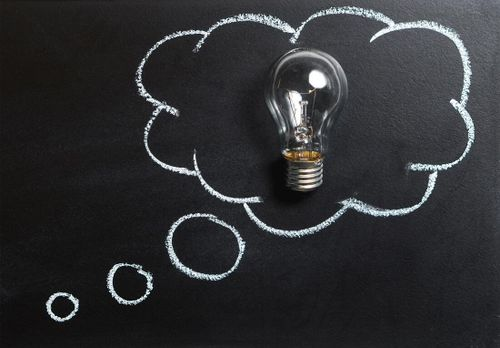 Light bulb representing innovation and creativity drawn on a chalkboard