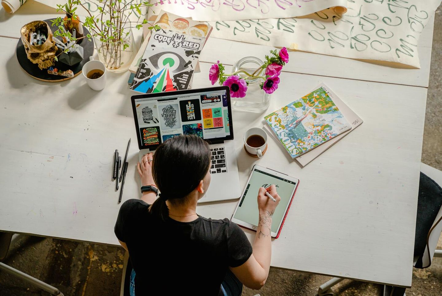 Woman illustrator working with a laptop and tablet