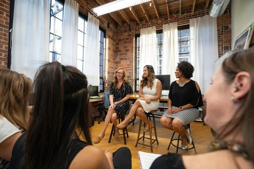 Three women in a panel doing a presentation to develop their personal brands.