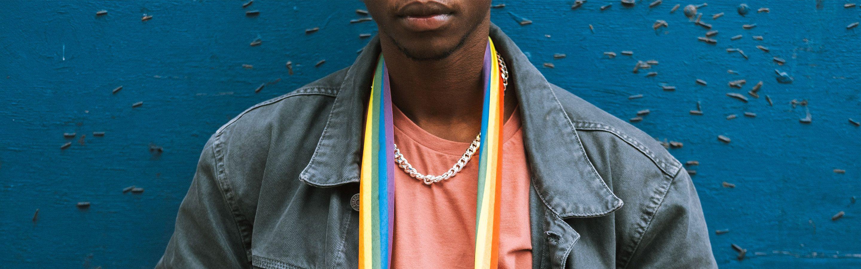 Person with rainbow sash