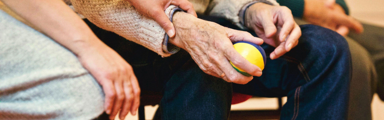 Senior citizen holding a ball