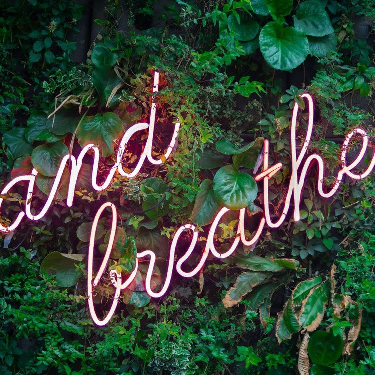 image of sign saying and breathe to help people calm down