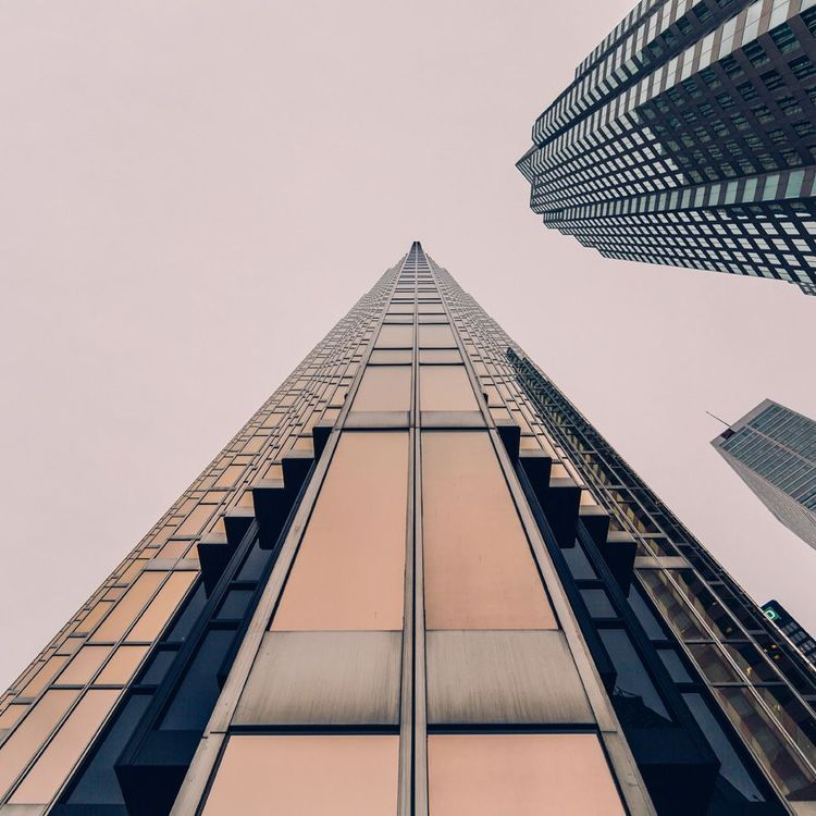 Skyscraper viewed from the sidewalk