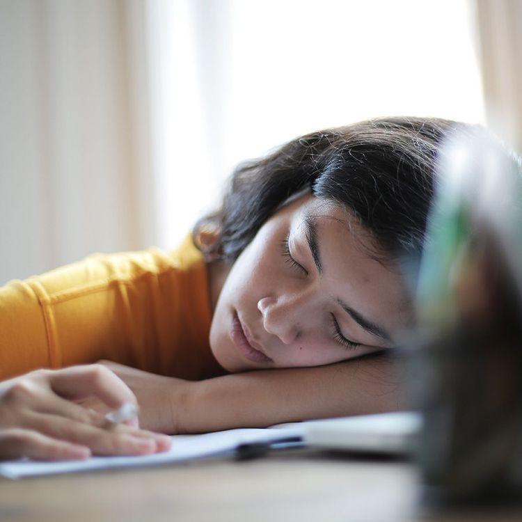 woman asleep at her desk