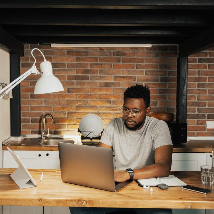 Man sitting in front of computer as he managing multiple projects