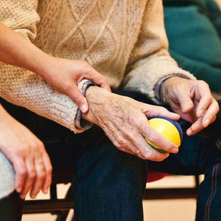 Senior citizen holding ball