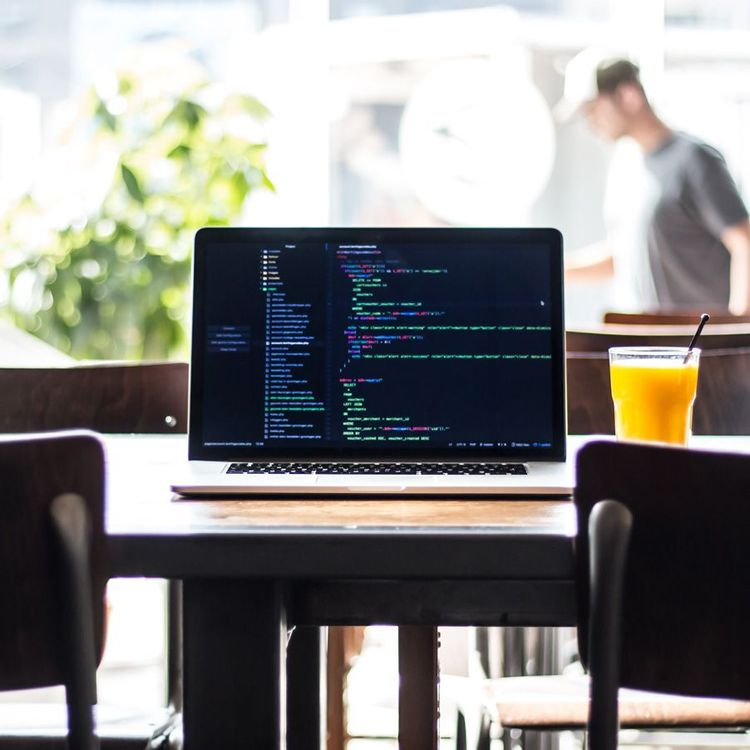 Freelance web developer working with code