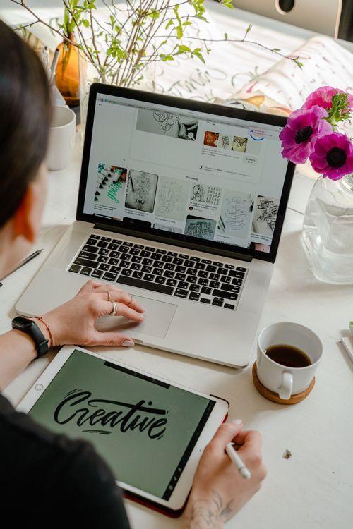 Freelance graphic designer working at her laptop