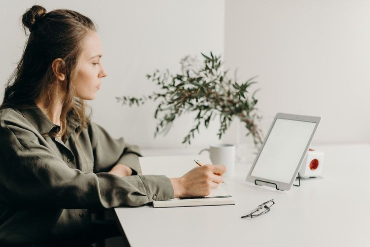 Freelancer working at her workstation using productivity tools