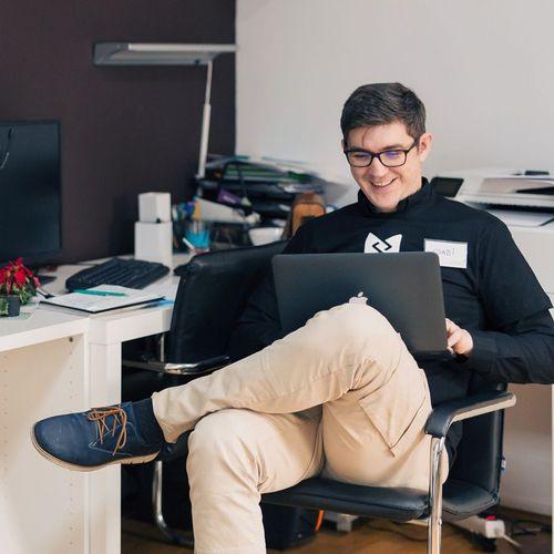 Freelance web developer working on computer