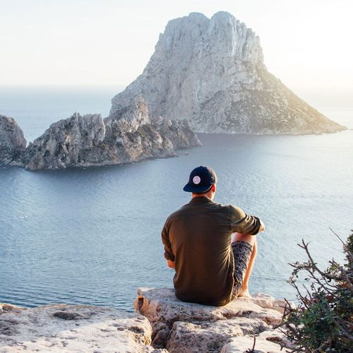 Freelancer sitting on a mountain