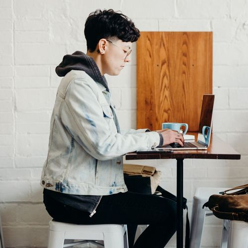 man searching freelance jobs online at the cafe