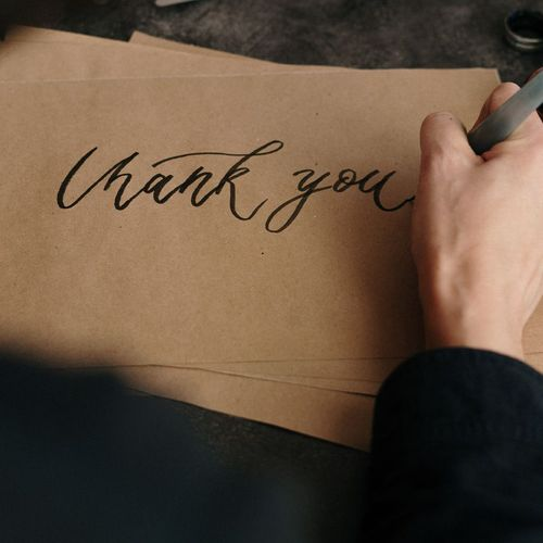 Freelancer writing a thank you letter to their client