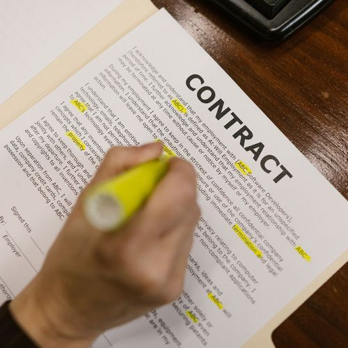 yellow highlighter over a contract