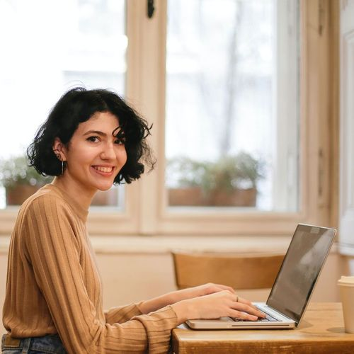 Smiling woman, satisfied that she chose freelancing over a full time job