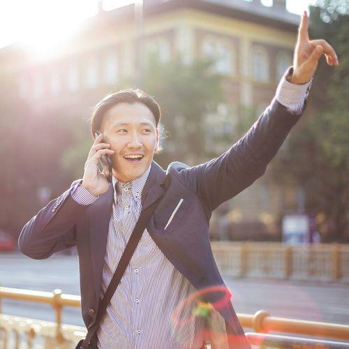 Man on phone hailing a taxi
