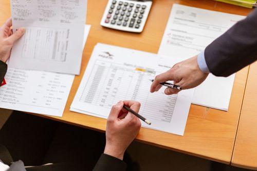Hands doing paperwork