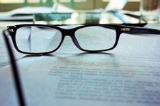 image of freelancer's glasses on graphic design retainer contract